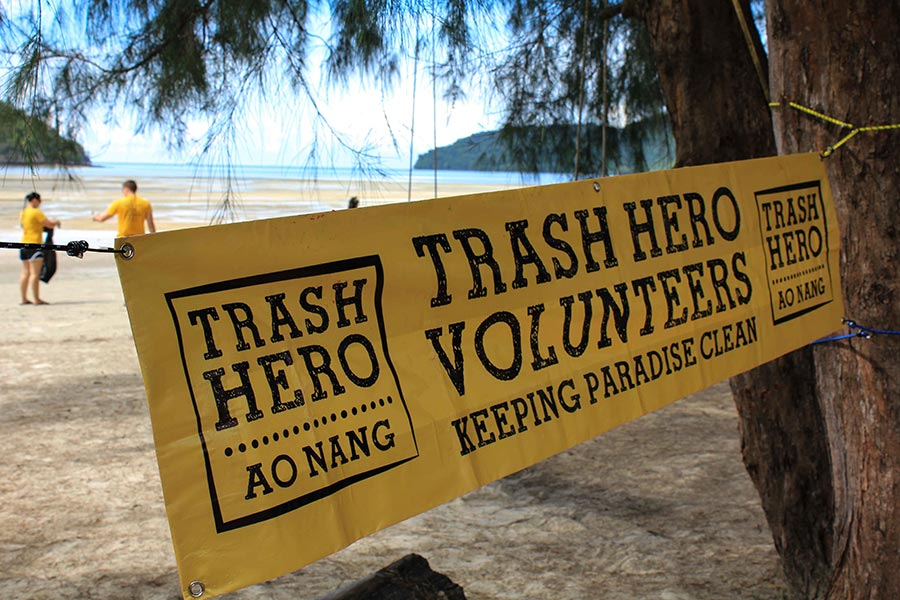 trash hero sunday with kon tiki sign